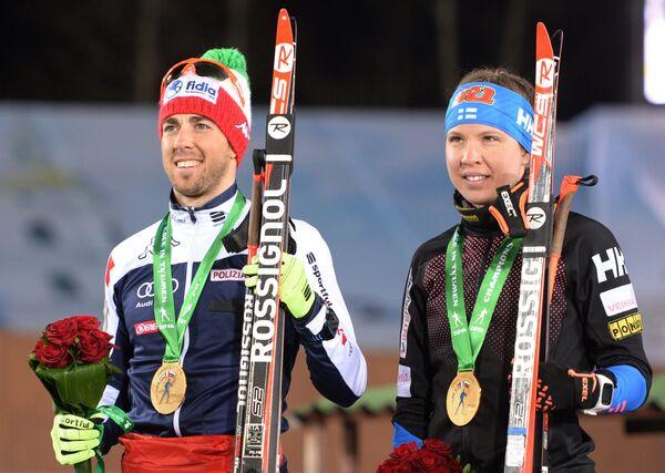 Победители смешанной эстафеты лыжников Гонки чемпионов-2016 в Тюмени Федерико Пеллегрино (Италия) и Кертту Нисканен (Финляндия)