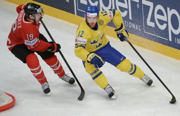Фредрик Петтерссон и Джастин Шульц (слева)